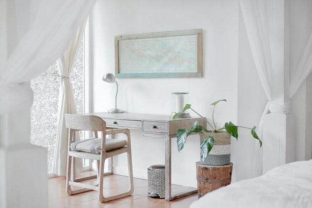A white room with a desk