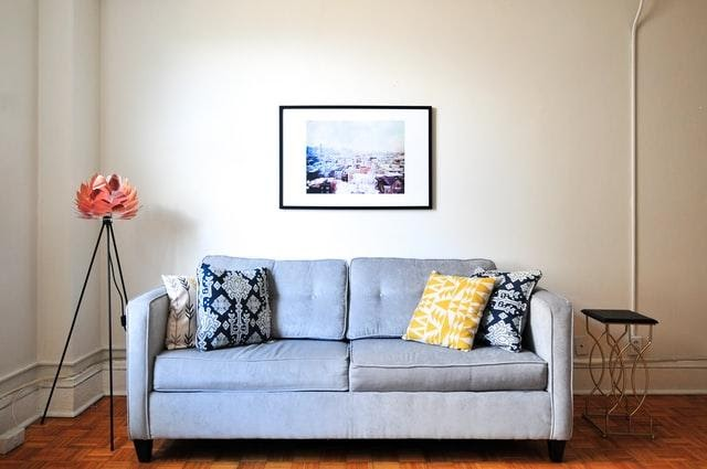 A gray sofa with colorful pillows
